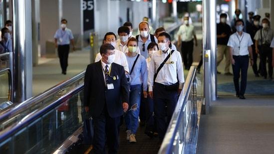Belarusian Sprinter Krystsina Tsimanouskaya who took refuge in the Polish embassy in Tokyo, arrives for a flight to Vienna at Narita International Airport in Narita, east of Tokyo, Japan August 4, 2021.(REUTERS)