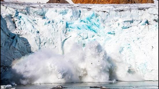 A mass of ice breaking away from the Apusiajik glacier, near Kulusuk (aslo spelled Qulusuk), a settlement in Sermersooq on the southeastern shore of Greenland. The Arctic has warmed three times more quickly than the planet as a whole, and faster than previously thought. (AFP)