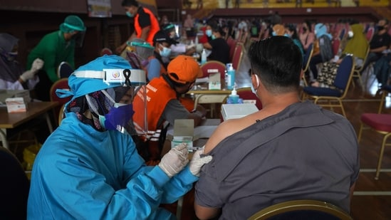 Jakarta has threatened to impose fines of up to $357 for refusing the Covid-19 vaccine.(Bloomberg)