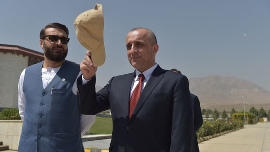 Afghanistan vice president Amrullah Saleh (right) gestures holding his cap as he stands along with National Security Adviser of Afghanistan Hamdullah Mohib as they wait for the arrival of Afghanistan's President Ashraf Ghani in Kabul.(AFP File Photo)