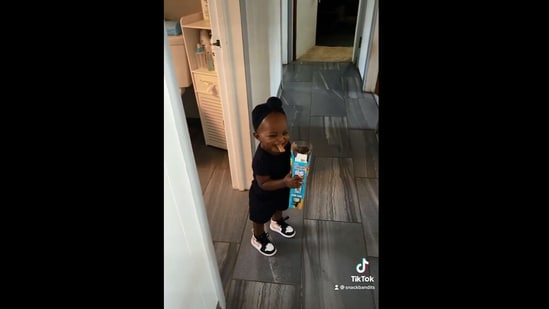 The image shows the little girl whose dad caught her stealing snacks.(Instagram/@snackbandits_dad)