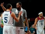 United States's Kevin Durant (7), center, celebrates with teammate Zachary Lavine (5) after their win in the men's basketball semifinal game against Australia at the 2020 Summer Olympics.(AP)