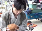 BTS member Jungkook with a chicken.