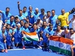 Indian players pose for photographs as they celebrate their victory over Germany in the men's field hockey bronze medal match, at the 2020 Tokyo Olympics(PTI)