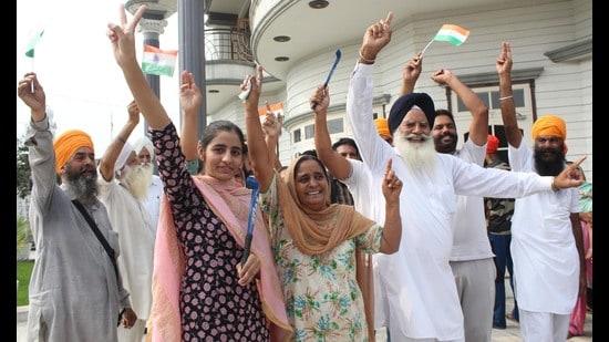 Indian hockey player Gurjant Singh's family members celebrate at Klehara village in Amritsar, district on Thursday. (Sameer Sehgal)