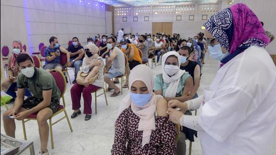 A Tunisian woman receives a dose of the Chinese Sinopharm vaccine at the Palais des Congres in the capital Tunis. (AFP)