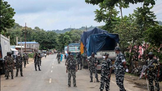 CRPF personnel stand guard at the national highway in Lailapur area near Assam-Mizoram border. (AFP)