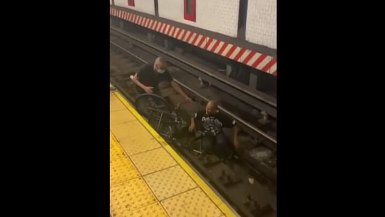 A New York man jumped down in the tracks and rescued a man on a wheelchair who fell inside.(Instagram/@subwaycreatures)