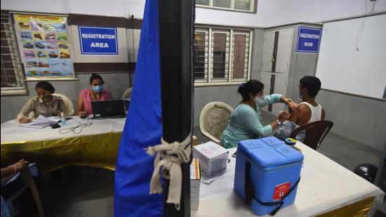 A health worker administers a dose of Covid-19 vaccine to a beneficiary, at a government school at DDU Marg in New Delhi, on August 2, 2021. (Raj K Raj/HT)