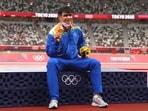 Tokyo 2020 Olympics- Gold medallist Neeraj Chopra of India reacts on the podium.(REUTERS)
