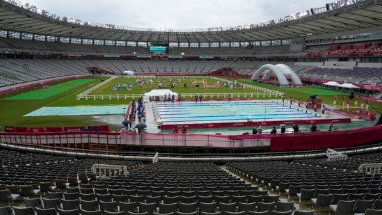 Empty stands are seen at the Tokyo Stadium as athletes compete in the swimming portion of the men's modern pentathlon at the 2020 Summer Olympics. (AP)