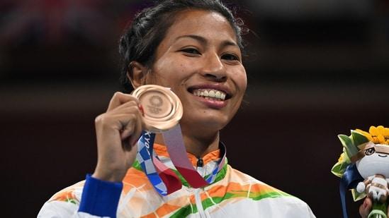 Bronze medallists Lovlina Borgohain of India poses for photos. Pool via REUTERS/Luis Robayo(REUTERS)