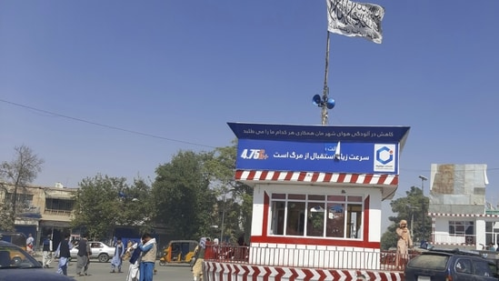 A Taliban flag flies in the main square of Kunduz city after fighting between Taliban and Afghan security forces, in Kunduz, Afghanistan. (AP Photo)