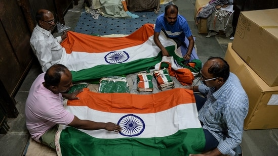 The MHA statement has asked states and UTs to ensure that paper national flags are not discarded or thrown on the ground after the completion of the I-day celebrations. (Photo by Indranil Mukherjee / AFP)