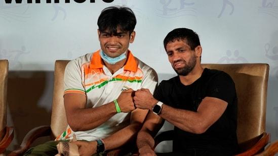 Javelin thrower Neeraj Chopra (L) and wrestler Ravi Dahiya (R)