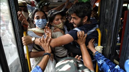 Demonstrators being detained during a protest against communal hatred at Jantar Mantar, on Tuesday. (Sanchit Khanna/HT Photo)