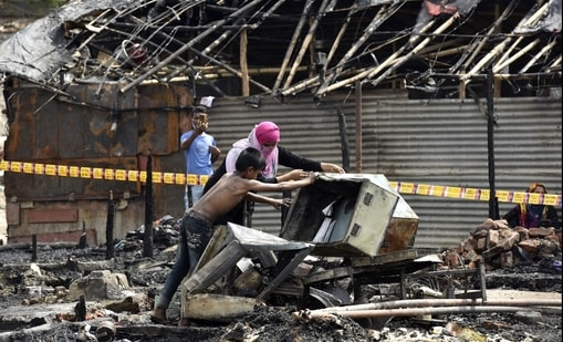The government said that illegal Rohingya migrants are indulging in illegal activities. Rohingya refugees inspecting an area after a fire broke out at a Rohingya camp near Kalindi Kunj on June 13.( Sunil Ghosh / Hindustan Times)