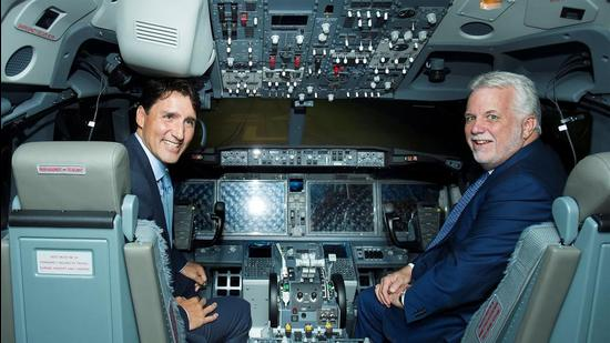 A file photo showing Canada's Prime Minister Justin Trudeau (left) and Quebec premier Philippe Couillard in a flight simulator during a visit to Canadian Aviation Electronics (CAE) in Montreal, Quebec, Canada on August 8, 2018. (REUTERS/FILE)