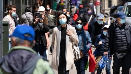 People walk the streets of New York, in the United States, as concerns peak over the spread of the delta variant of the coronavirus disease (Covid-19) in the country.(File Photo)