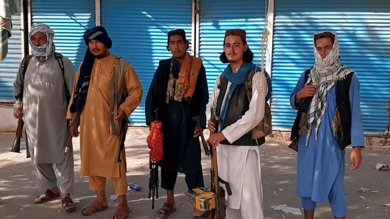 Taliban fighters stand guard in Kunduz city, northern Afghanistan. (AP)