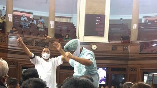 Congress MPs Partap Singh Bajwa and Ripun Bora protest inside the Rajya Sabha after opposition was not allowed to discuss on farmers issue, during the Monsoon Session of Parliament, in New Delhi.(PTI Photo)