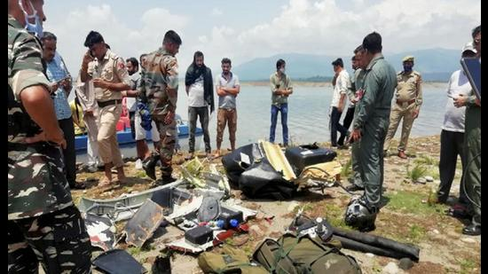 Army personnel inspect the site after an army helicopter crashed near Ranjit Sagar Dam Lake in Kathua district on August 3. (File photo)