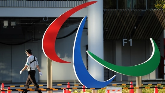 A security guard walks past the symbol of the Paralympic Games under installation at the National Stadium, the main venue of the Tokyo 2020 Olympic and Paralympic Games in Tokyo, Japan, August 10, 2021. (REUTERS)