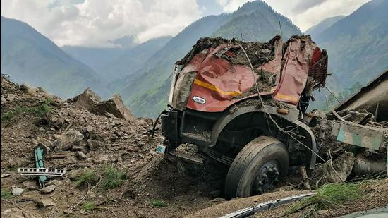 The mangled remains of a vehicle that was buried under the debris on the Reckong Peo-Shimla Highway in Kinnaur district on Wednesday. (PTI)