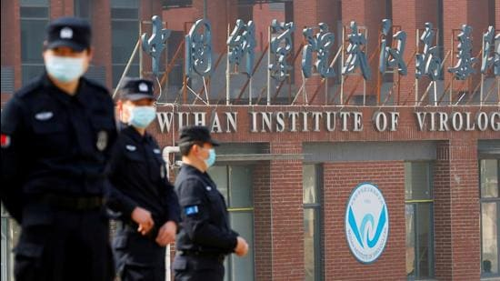 In this file photo, security personnel keep watch outside the Wuhan Institute of Virology in, Hubei province, China. (REUTERS)