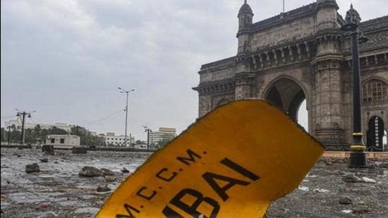 A signboard blown away by Cyclone Tauktae near Gateway of India in Mumbai on May 18, 2021. (PTI)