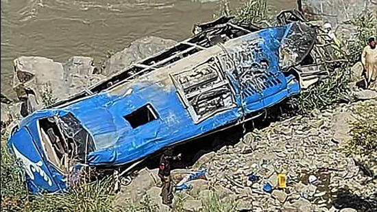 A bus that plunged into a ravine following a bomb attack in Kohistan district of Pakistan's Khyber Pakhtunkhwa province on July 14, 2021. (AFP/File)