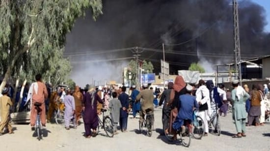Plumes of smoke rise into the sky after fighting between the Taliban and Afghan security personnel in Kandahar, Afghanistan, southwest of Kabul.(AP Photo)