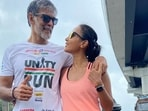Ankita Konwar happily poses with Milind Soman on the occasion of 75th Independence Day.(Instagram/Ankita Konwar)