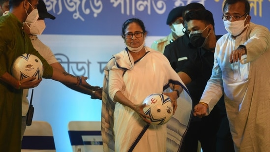 Chief Minister of West Bengal Mamata Banerjee seen with a football during an inaugural event of Khela Hobe Day to be observed on August 16.(Samir Jana/HT Photo)