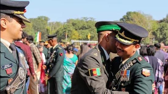 An Afghan National Army officer (centre) celebrates during the passing out parade at IMA, Dehradun. (HT File photo)