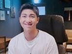 BTS leader RM uses embarrassing pics of members as his phone's wallpaper.