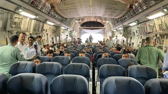 Indian diplomats and Indian journalists are seen inside the C-17 Globemaster before it took off from the Kabul airport.(MEA Photo)