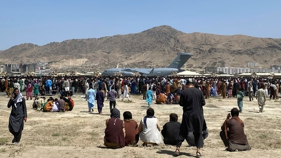 WHO's mobile health teams have been on hold in capital city Kabul for the past 24 hours as the city is besieged with chaos and disruptions(AP)