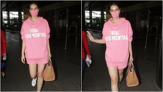 Kriti, on the other hand, opted for a monotone look for her arrival in Mumbai. She wore a blush pink oversized sweatshirt and shorts for the airport look. The droopy sleeves and loose silhouette of the hoodie added a laidback vibe to her outfit.(Varinder Chawla)