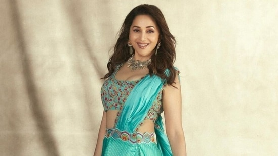 If looks could kill: Madhuri Dixit in pre-draped turquoise blue saree glams up Dance Deewane 3 stage(Instagram/@madhuridixitnene)