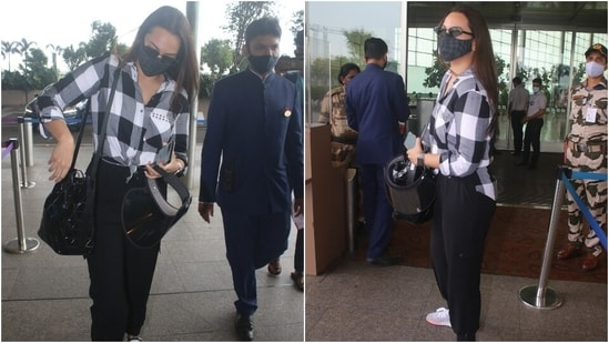 Sonakshi carried a black shoulder bag with her attire. She completed the look with a black face mask, vintage sunglasses, lace-up shoes, a watch and middle-parted open tresses. (Varinder Chawla)