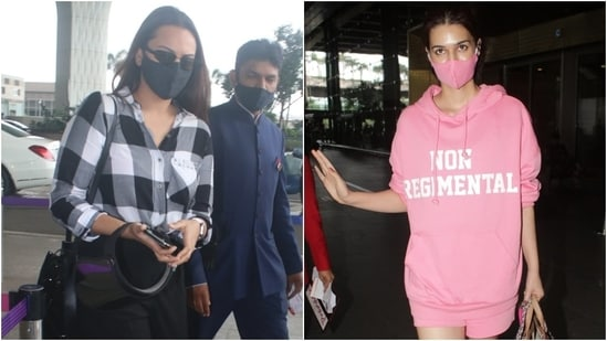 Bollywood actors Sonakshi Sinha and Kriti Sanon were snapped at the Mumbai airport today. For their airport looks, both the stars chose comfort over fashion and rocked uber-cool ensembles. While Sonakshi opted for darker hues for her flight out of Mumbai, Kriti chose a bright monotone outfit for her arrival in the bay.(Varinder Chawla)