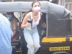 Alia Bhatt hops out of an auto rickshaw in Mumbai.