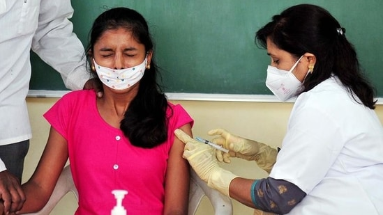 A healthcare worker inoculates a dose of the vaccine against coronavirus to a beneficiary. (ANI)