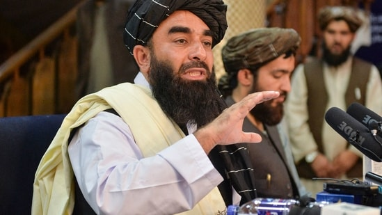 Taliban spokesperson Zabihullah Mujahid addressing the first press conference in Kabul on August 17.(AFP)