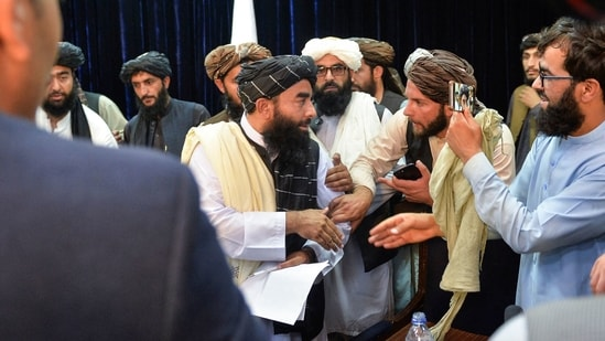 Taliban spokesperson Zabihullah Mujahid interacts after addressing the press conference. (AFP)