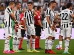 Juventus' Portuguese forward Cristiano Ronaldo (C) chats with Juventus' defender Leonardo Bonucci from Italy (2nd L)(AFP)