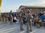 G7 called for the militants to guarantee safe passage to Afghan nationals and foreigners who want to leave the country. In picture - US soldiers stand guard as Afghan people wait to board a military aircraft to leave Afghanistan at the airport in Kabul.(AFP)