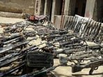 Taliban showcasing seized weapons from fleeing Afghan and allied forces.