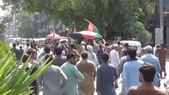 People carry Afghan flags as they take part in an anti-Taliban protest in Jalalabad, Afghanistan.(via Reuters)